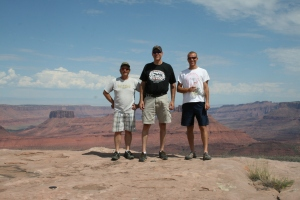 Mike, Dave, and Tyler at the overlook on Porcupine Rim, with Castle Valley in the background