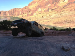 Jonny getting a little bit of air under his front tires at the last obstacle before the cliff on Moab Rim